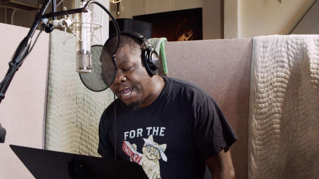 Black men recording a song